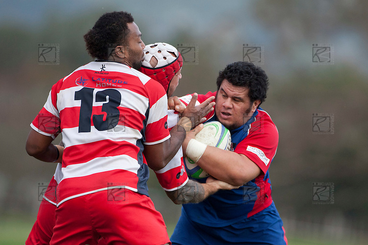 Jeremaih Fatialofa runs into the tackle of DJ Forbes and Seremaia Tagicakibau. Counties Manukau Premier Club Rugby game between Ardmore Marist and Karaka played at Bruce Pulman Park Papakura on Saturday June 11th 2011. Karaka won 42 - 25 after leading 21 - 18 at the break.