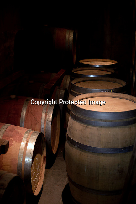 A storage room for wine barrels at Stellekaya vinery in Stellenbosch outside Cape Town, South Africa.
