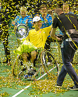 Rotterdam, The Netherlands. 15.02.2014. Shingo Kunieda(JPN) receiving his trophy at the ABN AMRO World Wheelchair tennis Tournament<br /> Photo:Tennisimages/Henk Koster