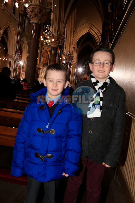 Evan and James Smith at the Mass in st Peters.<br /> Archbishop Eamon Martin, Coadjutor Archbishop of Armagh, celebrated Mass in Saint Peter&rsquo;s Church, Drogheda, on Sunday 26 January to mark the start of Catholic Schools Week.<br /> Picture: Fran Caffrey www.newsfile.ie