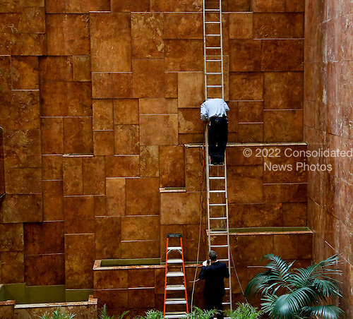 A worker repairs the fountains located in the Trump Tower while United States President-elect Donald Trump holds meetings on top floors of the Trump Tower, November 21, 2016, in New York, New York.<br /> Credit: Aude Guerrucci / Pool via CNP