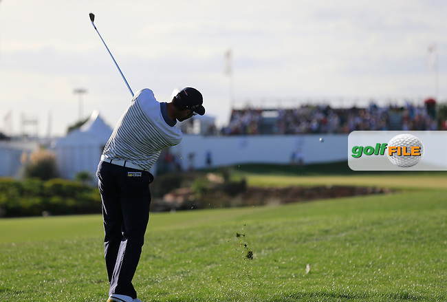Alvaro Quiros (ESP) plays his 2nd shot on the 18th hole during Saturday's Round 3 of the 2013 Portugal Masters held at the Oceanico Victoria Golf Club. 12th October 2013.<br /> Picture: Eoin Clarke www.golffile.ie