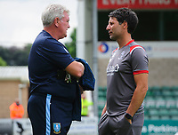 Sheffield Wednesday's manager Steve Bruce, left, speaks to Lincoln City manager Danny Cowley prior to the game<br /> <br /> Photographer Chris Vaughan/CameraSport<br /> <br /> Football Pre-Season Friendly - Lincoln City v Sheffield Wednesday - Saturday July 13th 2019 - Sincil Bank - Lincoln<br /> <br /> World Copyright © 2019 CameraSport. All rights reserved. 43 Linden Ave. Countesthorpe. Leicester. England. LE8 5PG - Tel: +44 (0) 116 277 4147 - admin@camerasport.com - www.camerasport.com