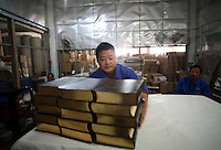 Workers at Amity Printing Co in Nanjing, 03 Dec 2007,  which is a joint venture with the United Bible Society that produces millions of bibles annually.<br />