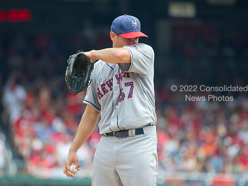 New York Mets starting pitcher Seth Lugo (67) wipes away the perspiration as he works in the fourth inning on a hot and humid Independence Day against the Washington Nationals at Nationals Park in Washington, D.C. on Tuesday, July 4, 2017.  <br /> Credit: Ron Sachs / CNP<br /> (RESTRICTION: NO New York or New Jersey Newspapers or newspapers within a 75 mile radius of New York City)