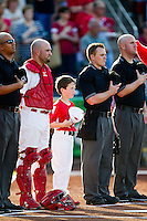 Nick Derba (18) of the Springfield Cardinals stands with a young fan and the umpires during the National Anthem prior to a game against the Arkansas Travelers at Hammons Field on May 5, 2012 in Springfield, Missouri. (David Welker/Four Seam Images).