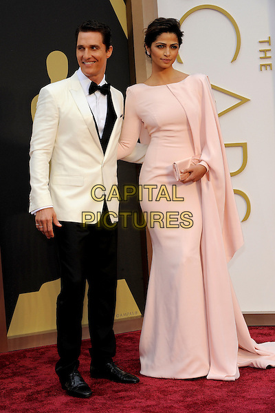 HOLLYWOOD, CA - MARCH 2: Matthew McConaughey, Camila Alves arriving to the 2014 Oscars at the Hollywood and Highland Center in Hollywood, California. March 2, 2014. <br /> CAP/MPI/COR99<br /> &copy;COR99/MediaPunch/Capital Pictures