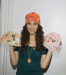 "All My Children's Alicia Minshew is going to be honored at Jane Elissa Leukemia Fall Benefit on October 8, 2013 and wears hats to show all availabilty for purchase at Hats for Health which benefits Leukemia. Go to www.hatsforhealth.com to see hats. Actors show off Jane Elissa's hats, jackets, shawls, luggage, umbrellas and Jane's new book ""Diary of a Lollipop in a Peanut Factory"" taken at Jane's apartment in New York City, New York. (Photo by Sue Coflin/Max Photos)"
