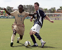 Brendan King #18 of the University of Notre Dame has his cross blocked by Aubrey Perry #3 of the University of South Florida during a Big East NCAA match at the University of South Florida on September20 2009, in Tampa, Florida.South Florida won 2-1 .