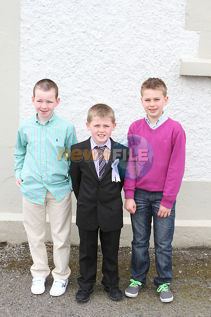 Conor McArdle, Damiel O'Connell and David O'Connell at Phillipstown Communion in St.Kevins Church...(Photo Jenny Matthews/www.newsfile.ie)