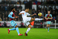Burnley's Georges-Kevin Nkoudou battles with Swansea City's Kyle Naughton<br /> <br /> Photographer Ashley Crowden/CameraSport<br /> <br /> The Premier League - Swansea City v Burnley - Saturday 10th February 2018 - Liberty Stadium - Swansea<br /> <br /> World Copyright &copy; 2018 CameraSport. All rights reserved. 43 Linden Ave. Countesthorpe. Leicester. England. LE8 5PG - Tel: +44 (0) 116 277 4147 - admin@camerasport.com - www.camerasport.com