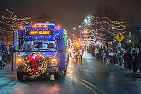 NWA Democrat-Gazette/ANTHONY REYES &bull; @NWATONYR<br /> A decorated Ozark Regional Transit bus leads a small section of the Christmas Parade of the Ozarks Monday Nov. 30, 2015 as spectators look on on Emma Avenue in Springdale. The parade featured a number of floats from local groups, businesses and politicians. It ended with an appearance from Santa Claus.