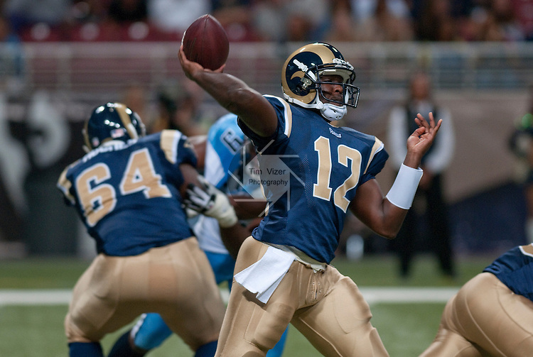20 August 2011                             St. Louis Rams quarterback Thaddeus Lewis (12) throws in the fourth quarter.  At left, St. Louis Rams offensive tackle Kevin Hughes (64) gives some blocking assistance. The St. Louis Rams defeated the Tennessee Titans 17-16 in a pre-season football game at the Edward Jones Dome in downtown St. Louis, Missouri on Saturday August 20, 2011.