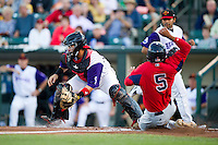 Rochester Red Wings catcher Rene Rivera #13 attempts to tag Reynaldo Rodriguez #5 sliding in safely during an International League game against the Pawtucket Red Sox at Frontier Field on August 11, 2012 in Rochester, New York.  Rochester defeated Pawtucket 5-3.  (Mike Janes/Four Seam Images)