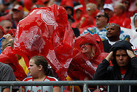 Buckeyes fans scramble to put on covers as the rain starts to pour before the college football game between the Ohio State Buckeyes and the Northern Illinois Huskies at Ohio Stadium in Columbus, Saturday afternoon, September 19, 2015. (The Columbus Dispatch / Eamon Queeney)