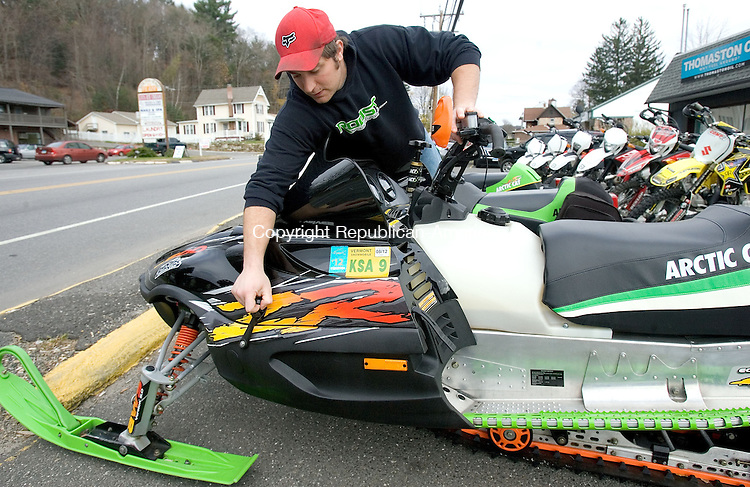 THOMASTON, CT. 05 November 2012-110512SV03-Nick Ferguson of Roost Power Sports gets the snowmobiles ready for customers at the shop in Thomaston Monday. Ferguson said people are jumping from quads to sleds fast this year and with a possible nor'easter headed this way everybody is thinking of snow..Steven Valenti Republican-American