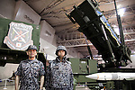 "Militaries pose for the camera next to a missile launcher at the Niconico Douga fan event in Makuhari Messe International Exhibition Hall on April 25, 2015, Chiba, Japan. The event includes special attractions such as J-pop concerts, Sumo and Pro Wrestling matches, cosplay and manga and various robot performances and is broadcast live on via the video-sharing site. Niconico Douga (in English ""Smiley, Smiley Video"") is one of Japan's biggest video community sites where users can upload, view, share videos and write comments directly in real time, creating a sense of a shared watching. According to the organizers more than 200,000 viewers for two days will see the event by internet. The popular event is held in all 11 halls of the huge Makuhari Messe exhibition center from April 25 to 26. (Photo by Rodrigo Reyes Marin/AFLO)"