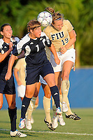 27 August 2011:  FIU's Sara Stewart (19) and Akron's Ashley Hughes (7) head the ball near the goal in the first half as the FIU Golden Panthers defeated the University of Arkon Zips, 1-0, at University Park Stadium in Miami, Florida.