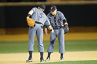Ian Happ (5) and Colin Hawk (2) of the Cincinnati Bearcats celebrate their win over the Wake Forest Demon Deacons at Wake Forest Baseball Park on February 21, 2014 in Winston-Salem, North Carolina.  The Bearcats defeated the Demon Deacons 5-0.  (Brian Westerholt/Four Seam Images)