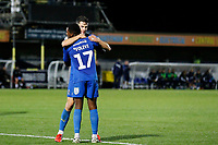 GOAL - Callum Reilly of AFC Wimbledon is congratulated for his goal during the The Leasing.com Trophy match between AFC Wimbledon and Leyton Orient at the Cherry Red Records Stadium, Kingston, England on 8 October 2019. Photo by Carlton Myrie / PRiME Media Images.