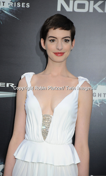 "Anne Hathaway in long white dress attends the world premiere of ""The Dark Knight Rises"" on .July 16, 2012 at The AMC Lincoln Square Imax Theatre in New York City. The movie stars Christian Bale, Gary Oldman, Anne Hathaway, Tom Hardy, Marion Cotillard, Joseph Gordon-Levitt and Morgan Freeman."