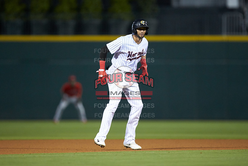 Paulo Orlando (16) of the Charlotte Hornets takes his lead off of second base against the Louisville Bats at BB&T BallPark on June 22, 2019 in Charlotte, North Carolina. The Hornets defeated the Bats 7-6. (Brian Westerholt/Four Seam Images)