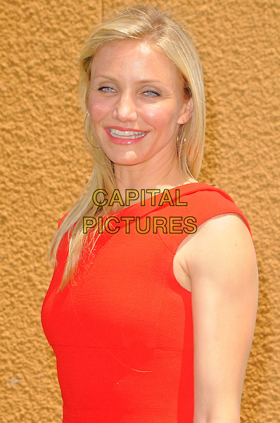 "CAMERON DIAZ .at DreamWorks Animation's ""Shrek Forever After"" L.A. Film Premiere held at Gibson Amphitheatre at Universal CityWalk, Universal City, California, USA, May 16th, 2010. .arrivals portrait headshot make-up lipstick red sleeveless smiling gold hoop earrings .CAP/ROT.©Lee Roth/Capital Pictures"