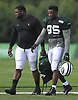 Josh Martin #95, right, heads off the field after a day of New York Jets Training Camp at the Atlantic Health Jets Training Center in Florham Park, NJ on Wednesday, Aug. 9, 2017.