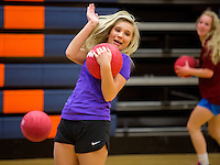 NWA Democrat-Gazette/JASON IVESTER <br /> Whitney Boone, Rogers Heritage senior, slips out of the way of a thrown ball during a game of dodgeball on Thursday, Nov. 12, 2015, at the school. Seventeen teams paid a $20 entry fee and student spectators paid $1 to raise money for United Way of Northwest Arkansas. Winning teams will compete in the championship of the tournament today (FRIDAY).