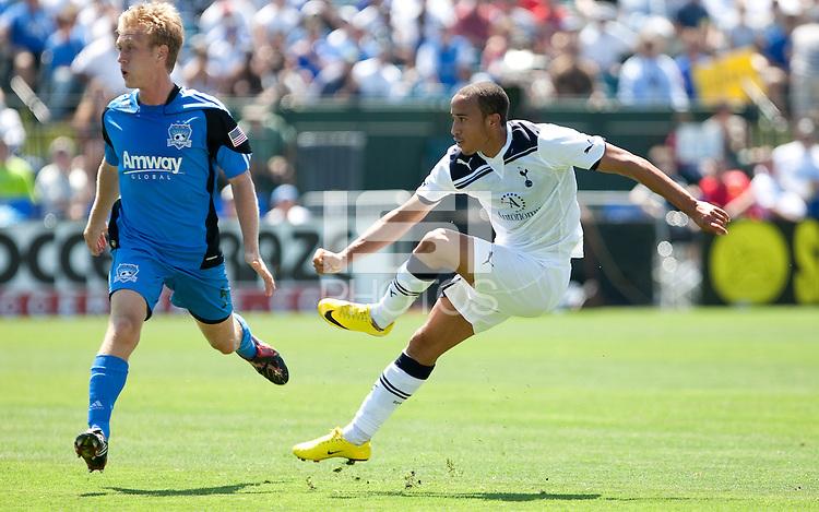 Andros Townsend (right) kicks the ball past Brad Ring (left). San Jose Earthquakes tied  Tottenham Hotspur 0-0 at Buck Shaw Stadium in Santa Clara, California on July 17th, 2010.