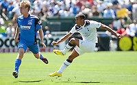 Andros Townsend (right) kicks the ball past Brad Ring (left). San Jose Earthquakes tied  Tottenham Hotspur 0-0 at Buck Shaw Stadium in Santa Clara, California on July 17th, 2010.