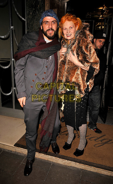 ANDREAS KRONTHALER & DAME VIVIENNE WESTWOOD .The 10th Anniversary Celebration of Claridge's Bar, Claridge's hotel, Brook St., London, England..November 11th, 2008.full length black tights pattern skirt brown fur jacket coat shawl cape grey gray suit  scarf married husband wife .CAP/CAN.©Can Nguyen/Capital Pictures.
