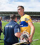 David Fitzgerald, Wexford Manager, congratulates Peter Duggan of Clare following their All-Ireland quarter final against Wexford at Pairc Ui Chaoimh. Photograph by John Kelly.