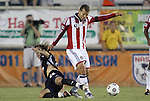 05 June 2012: Chivas USA's Alejandro Moreno (VEN) (right) gets past Carolina's Zach Schilawski (22). The Carolina RailHawks (NASL) lost 1-2 to Club Deportivo Chivas USA (MLS) at WakeMed Soccer Stadium in Cary, NC in a 2012 Lamar Hunt U.S. Open Cup fourth round game.
