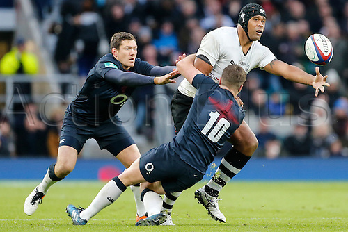 19.11.2016. Twickenham, London, England. Autumn International Rugby. England versus Fiji.  Akapusi Qera of Fiji offloads as George Ford of England makes the tackle.   Final score: England 58-15 Fiji.