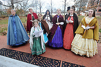 NWA Media/Michael Woods --12/07/2014-- w @NWAMICHAELW...Members of the Heritage School dressed in period attire sing Christmas carols in front of the Headquarters House in Fayetteville as they help celebrate the holiday season. The evening included music and food for visitors at the historical civil war era home.