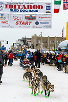 Larry Daughtery and team leave the ceremonial start line with an Iditarider and handler at 4th Avenue and D street in downtown Anchorage, Alaska on Saturday March 7th during the 2020 Iditarod race. Photo copyright by Cathy Hart Photography.com