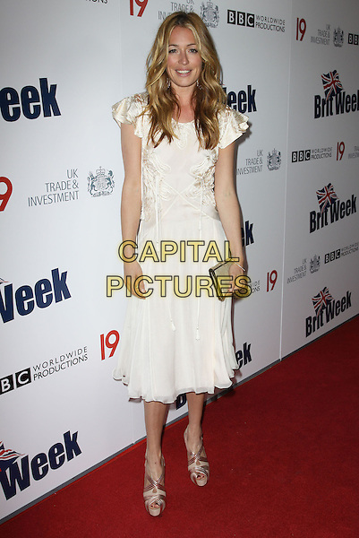 CAT DEELEY.The BritWeek 2010 Champagne Launch held At The British General Consul Residence, Los Angeles, California, USA..April 20th, 2010.full length white silk satin sheer dress vintage beige shoes clutch bag gold .CAP/ADM/KB.©Kevan Brooks/AdMedia/Capital Pictures.