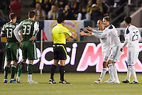 LA Galaxy players Landon Donovan (10) and David Beckham (23) plead their case with referee Ramon Hernandez. The LA Galaxy defeated the Portland Timbers 3-0 at Home Depot Center stadium in Carson, California on  April  23, 2011....