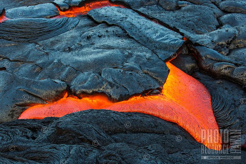 Molten Crust: Molten lava emerges from under its cooled surface, coastal plains of Pulama Pali (of Holei Pali), Puna district, Hawai'i Island, July 2017.