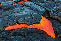 Molten Crust: Molten lava emerges from under its cooled surface, coastal plains of Pulama Pali (of Holei Pali), Puna district, Hawai'i Island, July 2017.