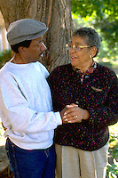 A friendly conversation between friends age 70 in the park.  St Paul  Minnesota USA