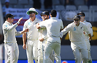 Kane Williamson celebrates with team mates after taking a catch to dismiss Broad.<br /> New Zealand Blackcaps v England. 1st day/night test match. Eden Park, Auckland, New Zealand. Day 1, Thursday 22 March 2018. &copy; Copyright Photo: Andrew Cornaga / www.Photosport.nz