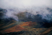 The all too present clouds add a sense of mystery to this wilderness landscape in the crater of  HALEAKALA NATIONAL PARK on Maui in Hawaii