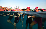 KONA-KAILUA, HI - OCTOBER 11:  Female competitors wait patiently to begin the 2.4-mile Waikiki Roughwater Swim at the 2014 IRONMAN Triathlon World Championships presented by GoPro on October 11, 2014 in Kailua-Kona, Hawaii. (Photo by Donald Miralle) *** Local Caption ***