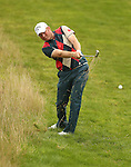 Welsh golfer Gareth Wright plays his second shot to the 4th green during the opening round of the ISPS Handa Wales Open 2013 at the Celtic Manor Resort<br /> <br /> 29.08.13<br /> <br /> ©Steve Pope-Sportingwales