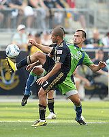Fred #7 of the Philadelphia Union knocks the ball away from Patrick Ianni #4 of the Seattle Sounders FC during the first MLS match at PPL stadium in Chester, Pa. on June 27 2010. Union won 3-2.