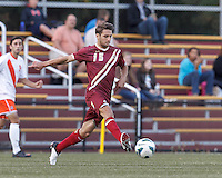 Boston College midfielder Giuliano Frano (15) passes the ball. Boston College (maroon) defeated Syracuse University (white/orange), 3-2, at Newton Campus Field, on October 8, 2013.
