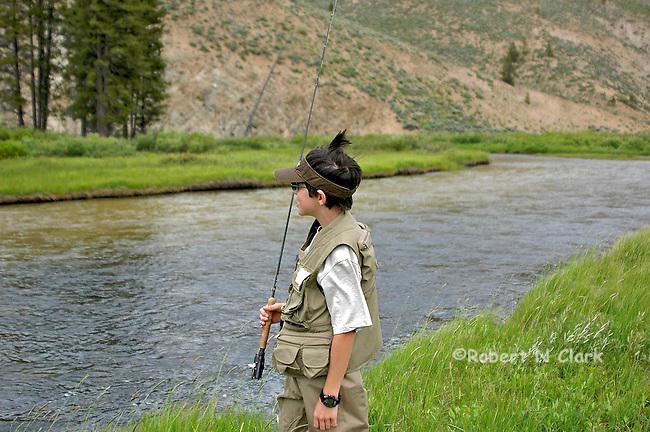 Young flyfisherman on Valley Creek near Stanley, Idaho