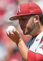 NWA Democrat-Gazette/CHARLIE KAIJO Arkansas pitcher Kacey Murphy (21) blows on a baseball during the second game of the NCAA super regional baseball, Sunday, June 10, 2018 at Baum Stadium in Fayetteville. Arkansas fell to South Carolina 5-8.
